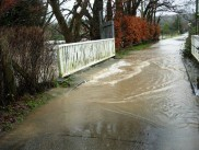 Hempstead Lane flooded on the approach to the horse sanctuary