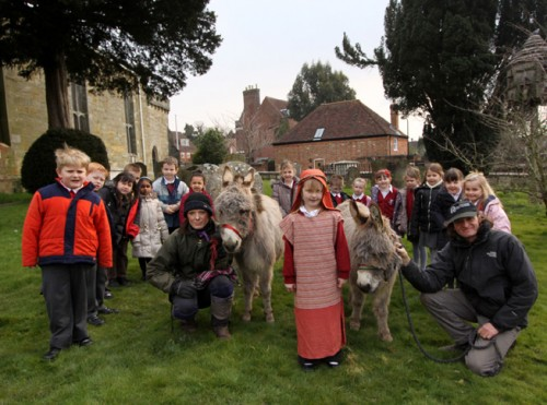 Donkeys join Holy Cross School children following a special Easter service.