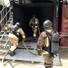 Uckfield firefighters enter purpose-built units to extinguish a fire in a controlled situation.