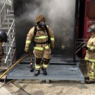 Job done, firefighters emerge from the smoke after a training exercise