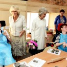 The Duchess of Cornwall, left, and the Duchess of Gloucester, chat with young disabled people at Chailey Heritage.
