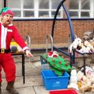 Long-serving UCTC teacher Jerry Gunn running a stall at the Christmas Indulgence