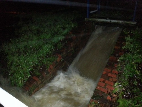 Water gushing down a channel near the roller mill in the early hours of December 24