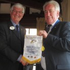 Steve Leonard (right) receives the District Governor's personal banner