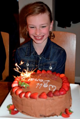 Nine-year-old Holly Richardson with a massive cake baked in her honour to celebrate completion of a two-mile sponsored swim.