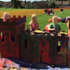 These children are hard at work painting a castle.