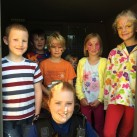 PCSO Megan Gardner is surrounded by children at the police CCTV van.