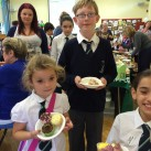 Bonners children show off some of the cakes at their Macmillan event.