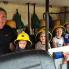 Michael Francis is pictured with some of the passengers in his fire engine. They are from the left Harry, two, and Isabelle Scothern, four, and Kelsey, four and William Russell, six.