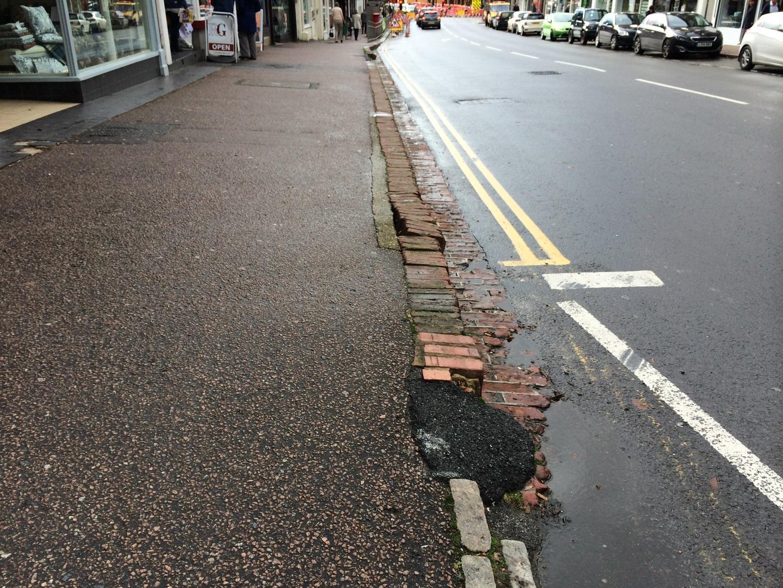Battered brickwork in steps outside Carvills.
