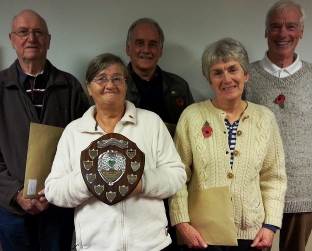 Pictured are Mrs Heather Berry, with trophy; and (from left) Mr M. Cosham, Mr P. J. Manning, Mrs Mary Ford and Mr Andrew Ford.