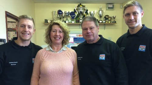 Four members of the Cockill family who run Uckfield Motor Services. Melanie and Symon are with sons Edward, left, and Harry - See more at: https://uckfieldnews.com/uckfield-motor-services-celebrates-20-years-on-the-bellbrook-estate/#sthash.1LBYtKWK.dpuf