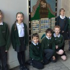 Manor children with their school's mural.