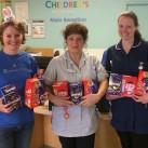 Laura Manton, left, presents eggs for children at the Royal Alexandra Children's Hospital.
