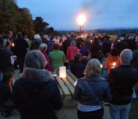Quiet contemplation at the candlelit vigil for the Fr Martin Onions