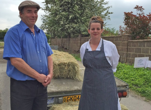 Farmer Peter Berry and farmers market organiser Stephanie Wheeler next to the trailer which carries people on rides around Birdineye Farm.