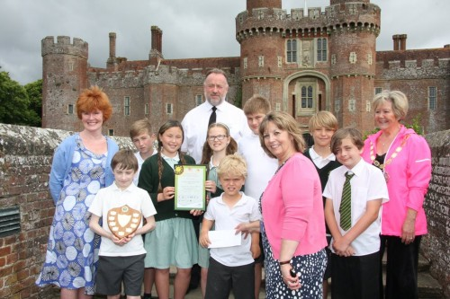 St Philip's, Uckfield, winner of the Lawrence Reeve award. Pictured with the children are (from left) Debbie Reeve, PC Pete Cook and Brenda Robinson from Servomex