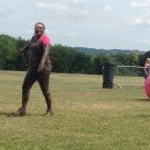 The intrepid Ridgewood Post Office team having successfully cleared an inflatable obstacle at Pretty Muddy.