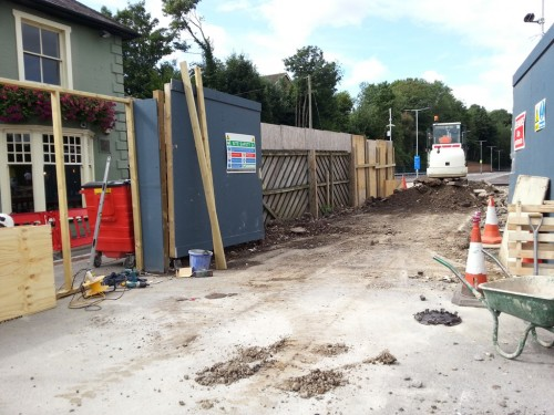 New fencing going up between the station car park approach road and the pub