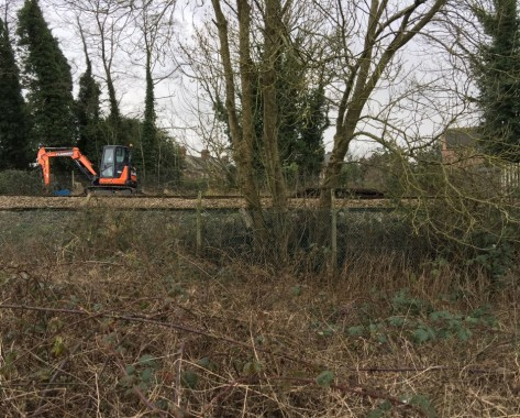 A digger on the site of the extension to the platform at Uckfield railway station