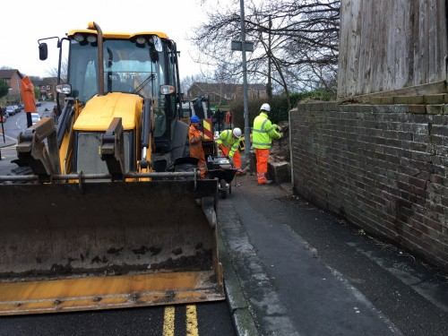 Work on making a wall safe in Framfield Road, Uckfield, near the junction with High Street