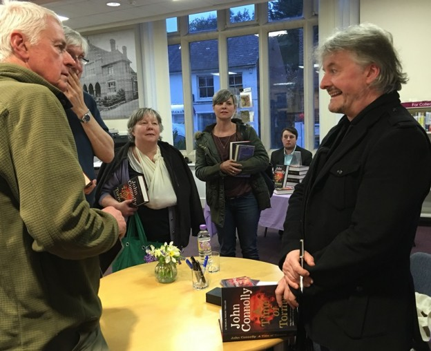 Best-selling author John Connolly talking to members of the audience who attended his talk at Uckfield public library