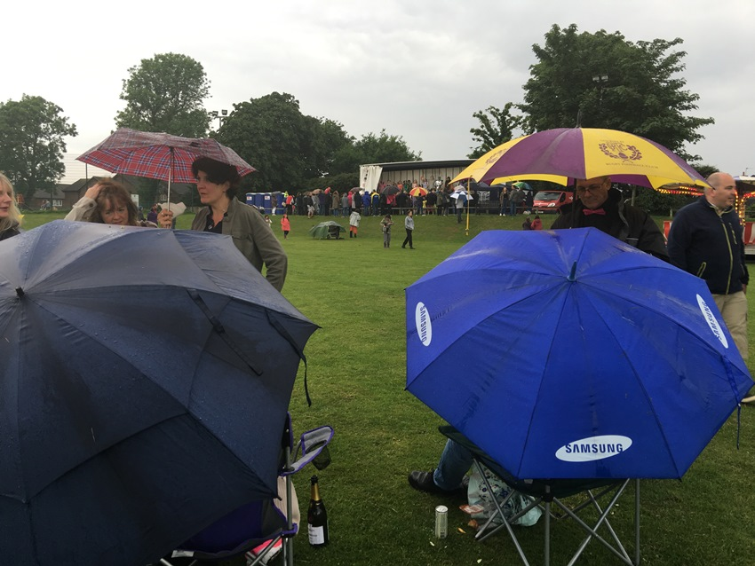 The show must go on with visitors sheltering under umbrellas