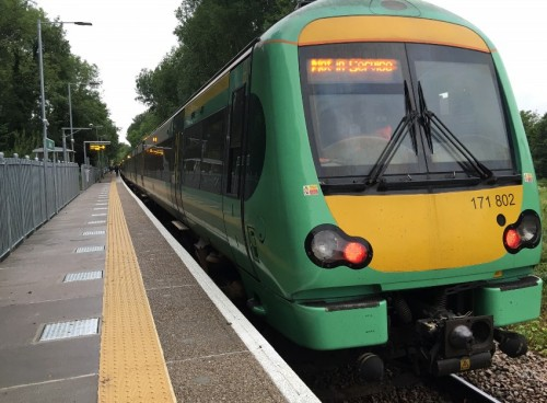 A ten-car train sits at the extended Uckfield railway station platform with an 07:05 service to London Bridge