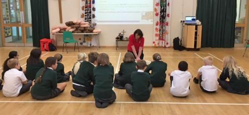 Helen Fairs with children at Buxted school during Restart a Heart Week