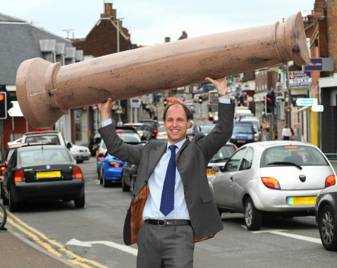 Allan Curtis, managing director of Uckfield-based Design and Display Structures. He is holding a GRP 'marble' column above his head.