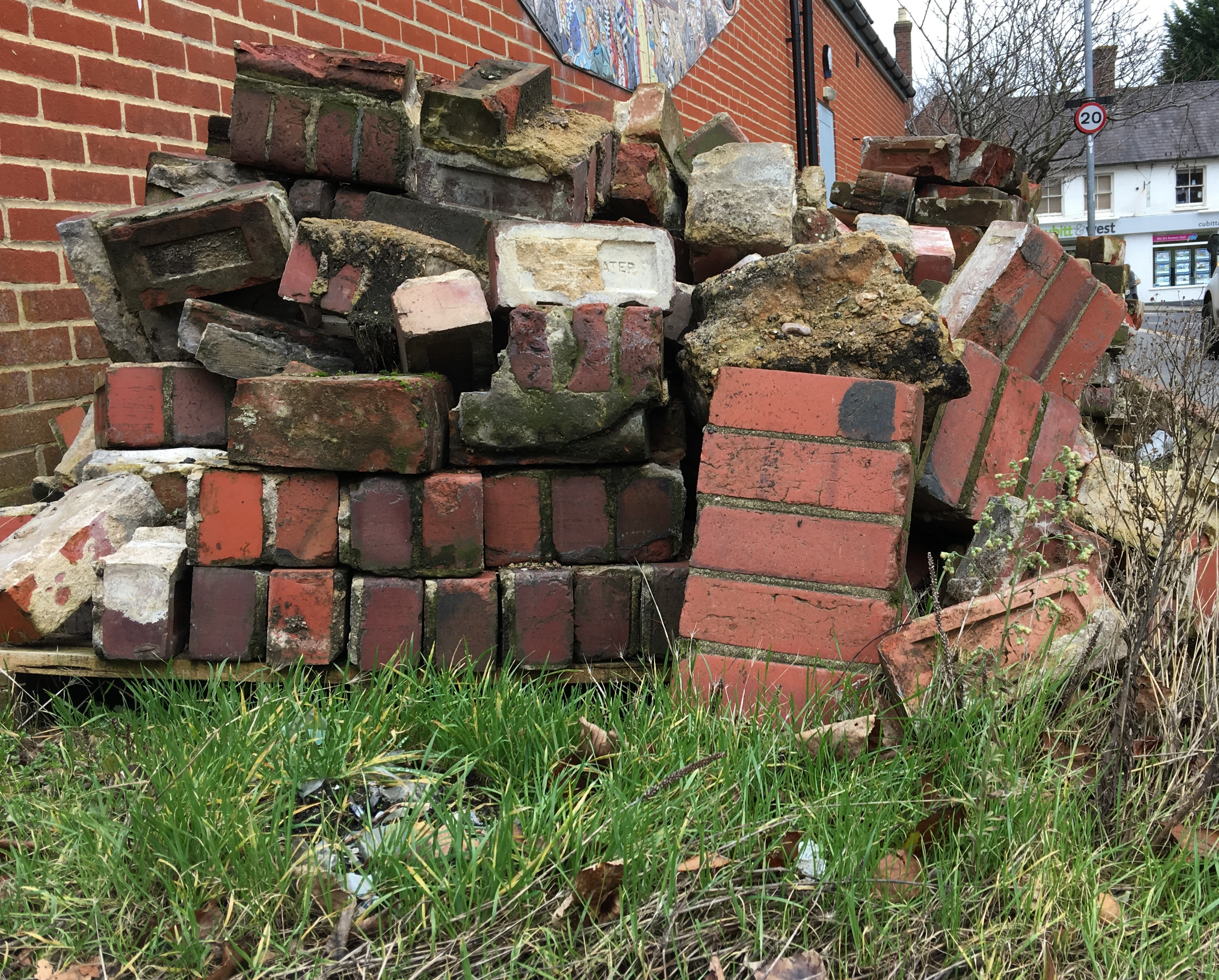 Historic red bricks stored on the side of Library Way, Uckfield, after their removal from the High Street during improvement works