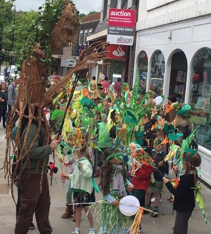 Holy Cross Pupils Parade on the High St led by Willow Woman  Structure