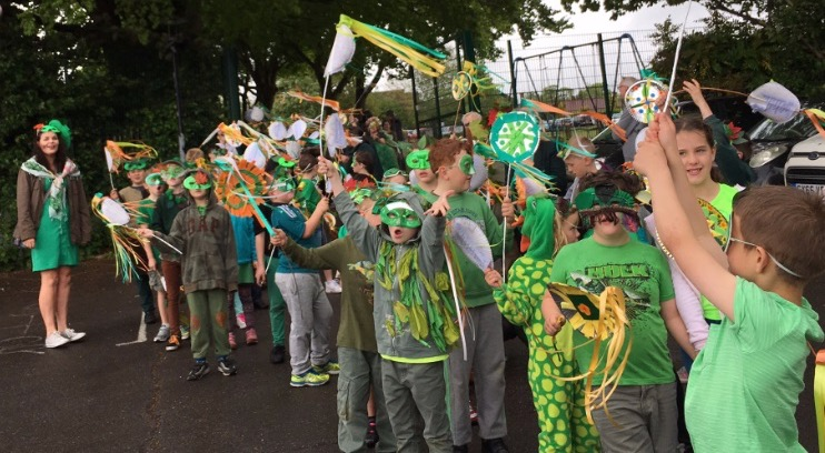 Parade Over Holy Cross Pupils Sing in School Car Park