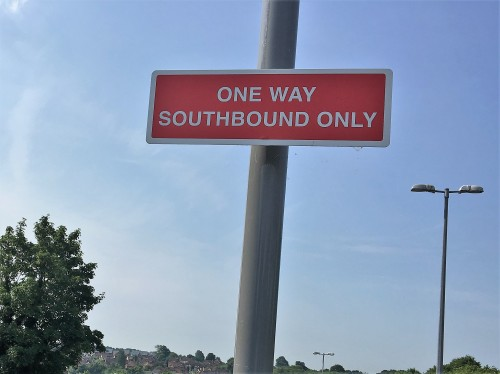 Sign to remind drivers it is one-way southbound in the Luxford Field car park on the eastern side
