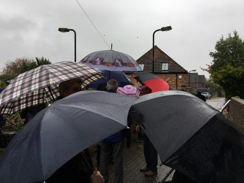 Sheltering from the rain . . . before the start of Uckfield's Act of Remembrance this morning