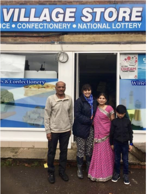 Nus Ghani Nus with Mrs Patel and her family outside Maresfield Village Store