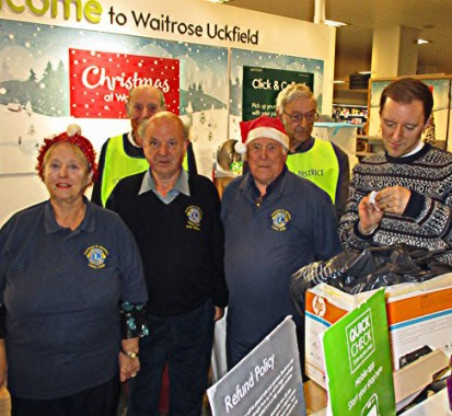 And the winner is . . . winning tickets pulled out during the 2017 Uckfield Lions Christmas draw at Waitrose