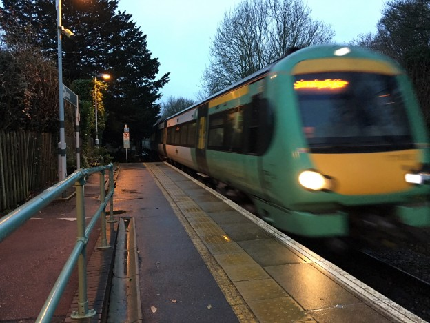 An Uckfield Line service arriving at a wet Buxted