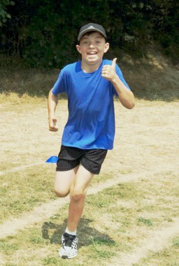 Thumbs up in the Race for Life at Harlands Primary School