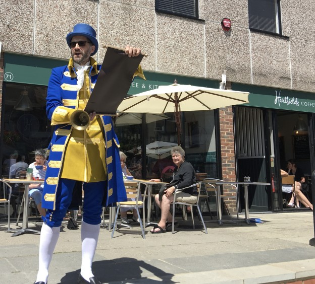 Town crier Ian Bedwell proclaims the Uckfield Festival outside Hartfields