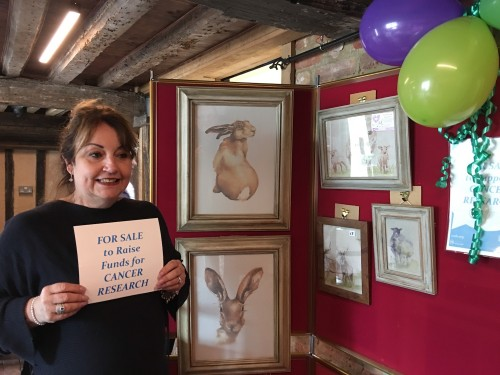 Zena Cooper who is selling prints within Bridge Cottage to raise money for Cancer Research
