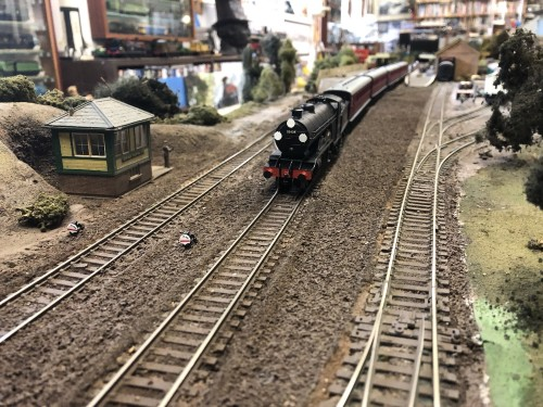 A Brighton Atlantic on a special to Brighton passing the shunters box for the goods yard at Uckfield railway station on David Yprkl's model. The box today is in use at Lewis nature reserve where it is used by bird watchers.