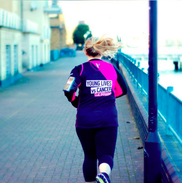 Millie running (back view)