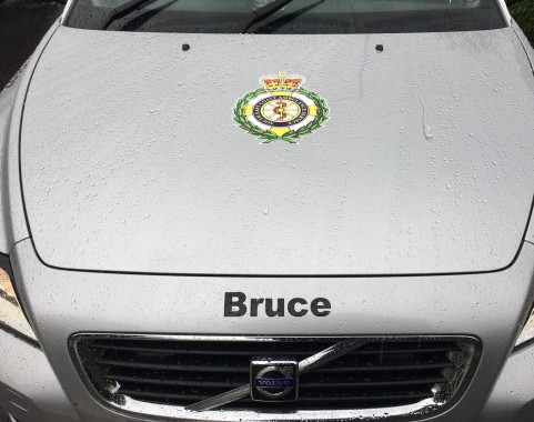 A SECAmb paramedic vehicle at Bruce Davy's funeral