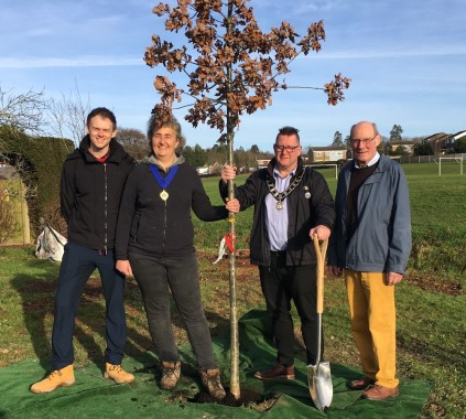 Councillors planting a tree at West Park in December 2019